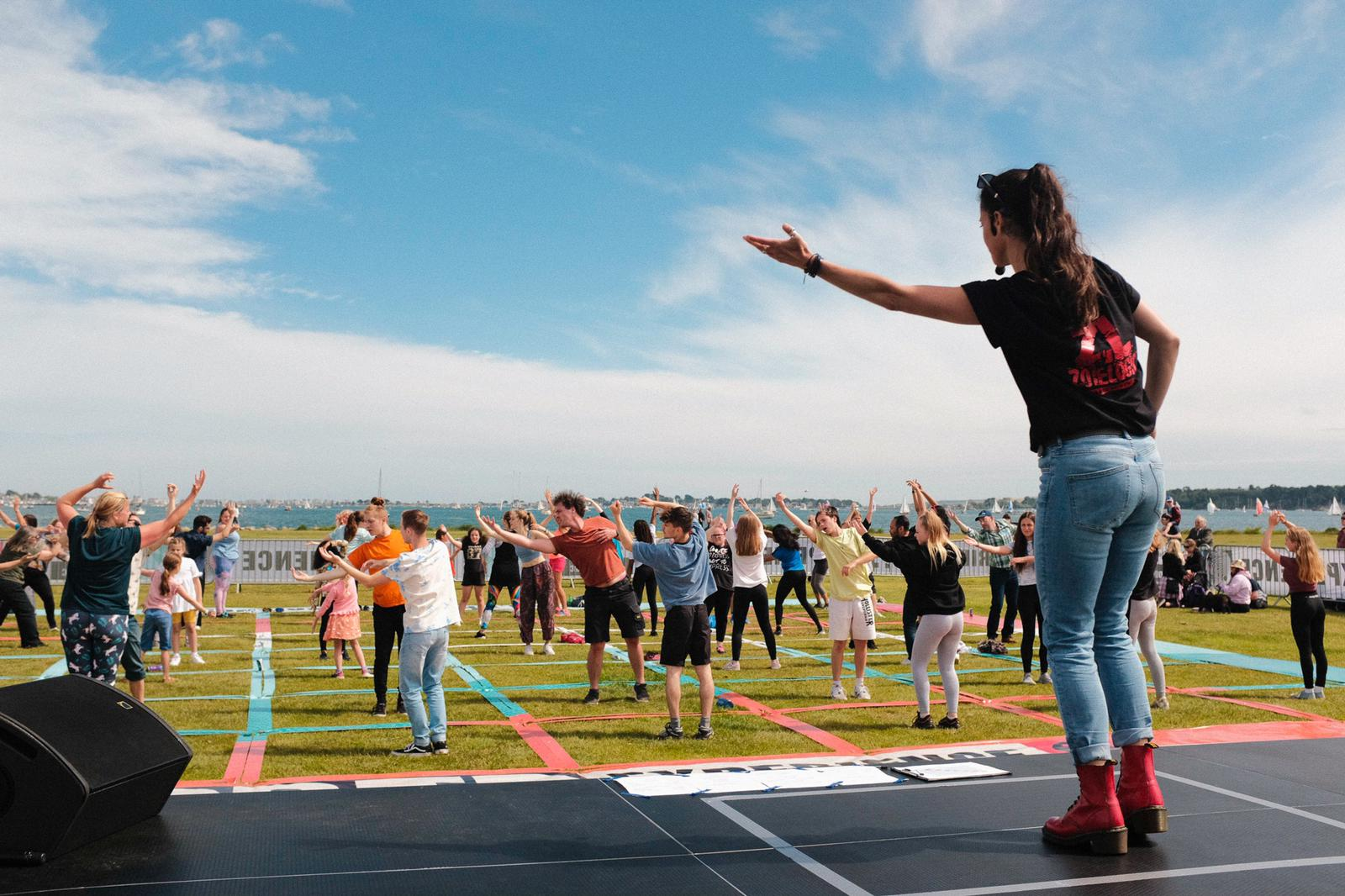 Dancers performing outside in a socially distanced grid