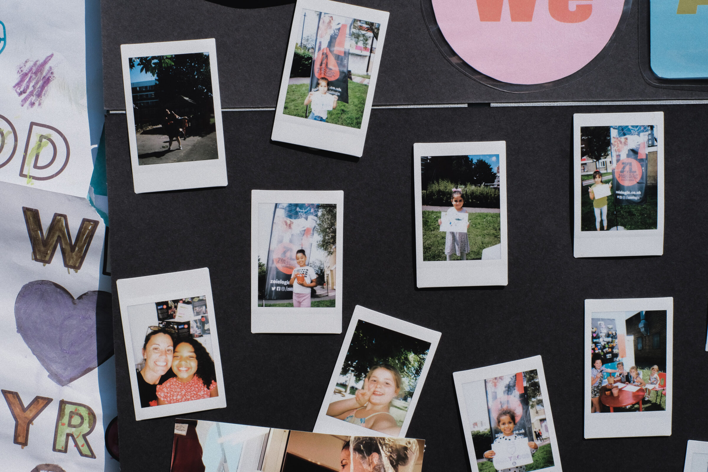 A display featuring instant camera pictures of young people on the Holyrood estate in Southampton