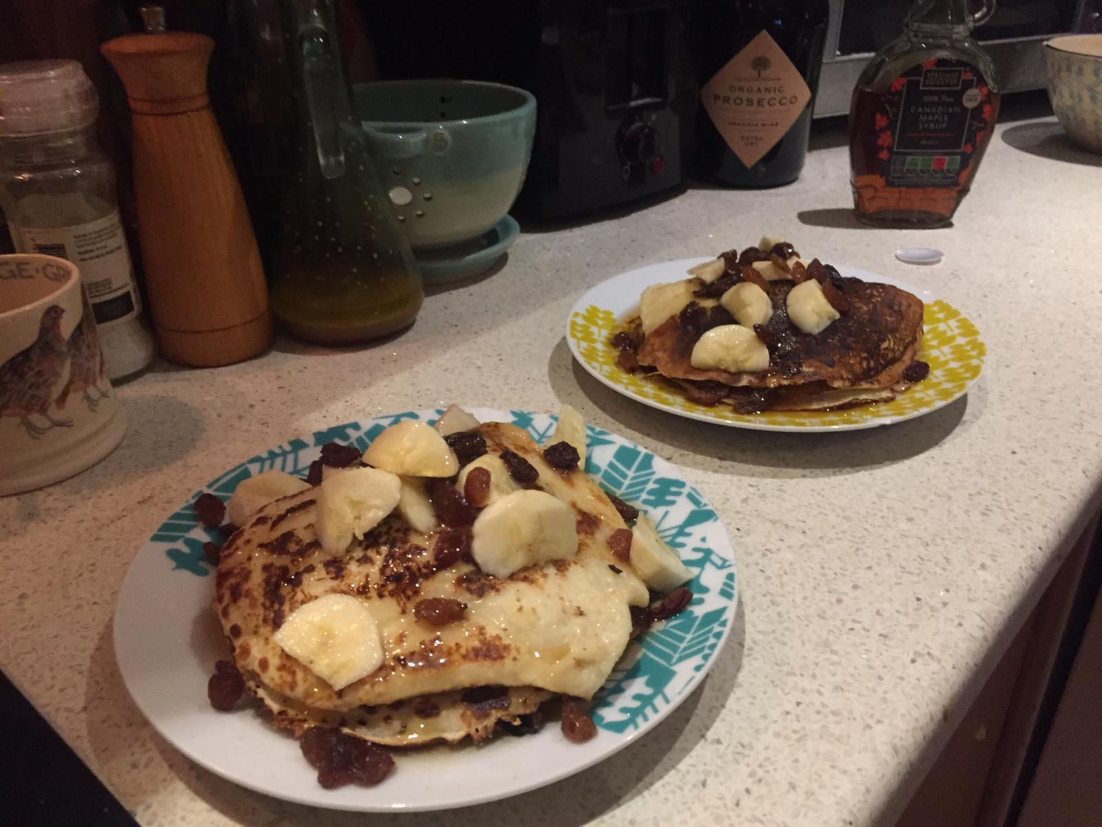 A photo of two plates of pancakes on a kitchen sideboard